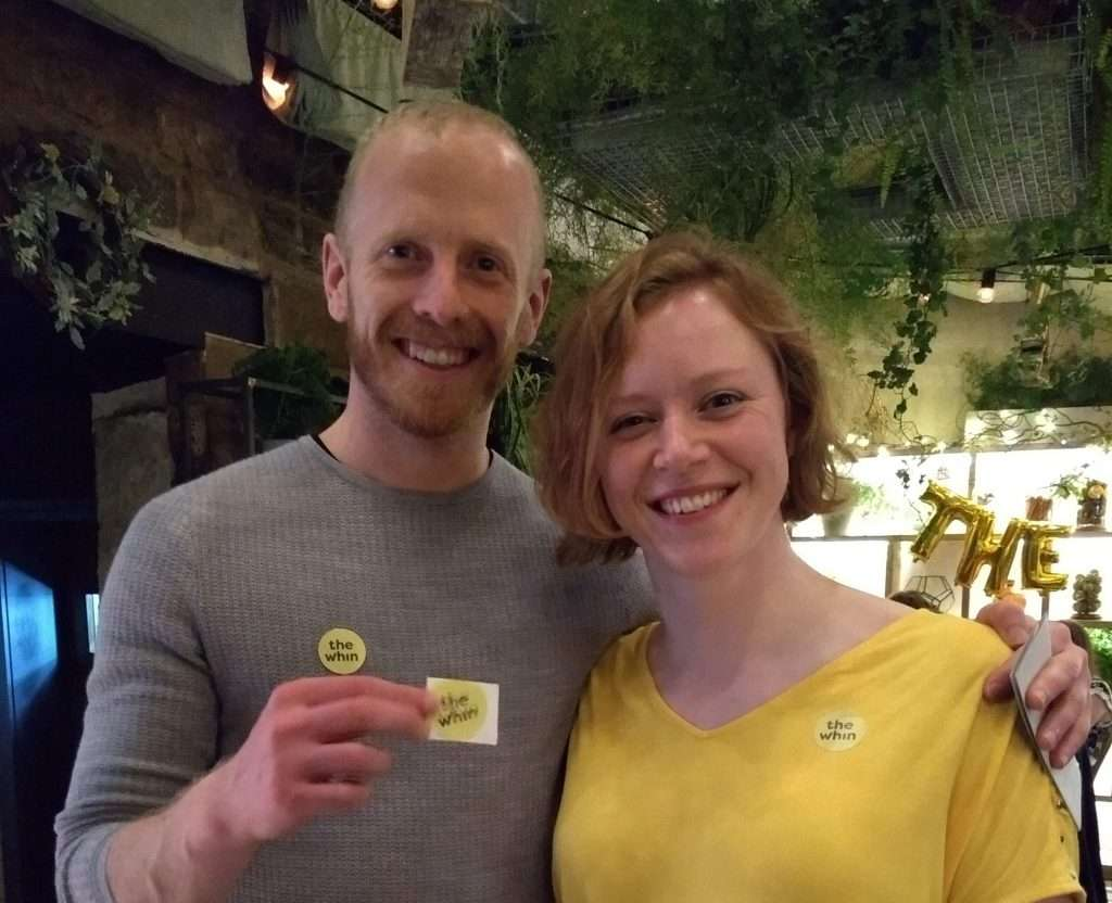 Andy and Katie wearing The Whin logo stickers