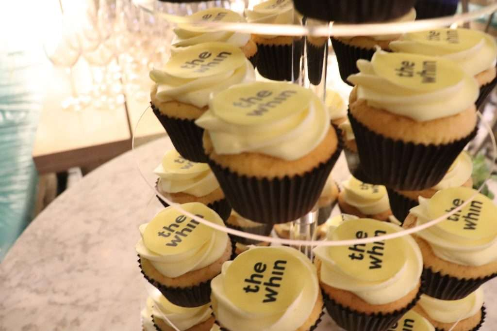 The Whin cupcakes on a clear stand
